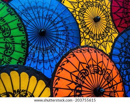 Colourful umbrellas at traditional street market in Bagan, Mandalay Region, Myanmar (Burma).  - stock photo