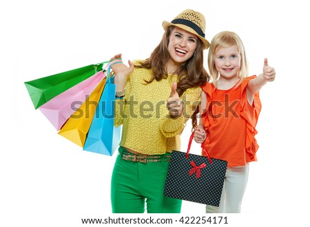 Colourful vibes of family shopping. Portrait of happy mother and daughter with shopping bags on white background showing thumbs up