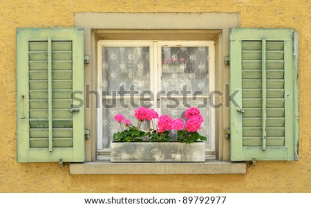 Colourful window with shutters. - stock photo