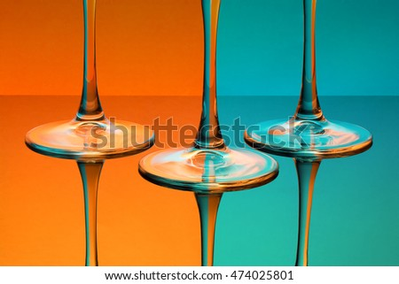colourful wine glasses orange and blue close up