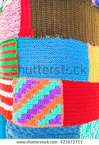 Colourful wool patchwork as a background - stock photo