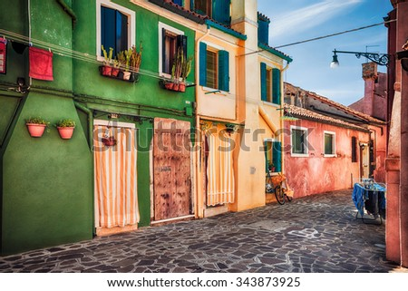 Colourfully painted house facade with windows on Burano island, province of Venice, Italy - stock photo