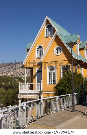 Colourfully painted house on a lookout in the hills above the harbour in the UNESCO World Heritage City of Valparaiso in Chile. - stock photo