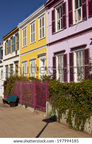 Colourfully painted houses on a lookout in the hills above the harbour in the UNESCO World Heritage City of Valparaiso in Chile. - stock photo