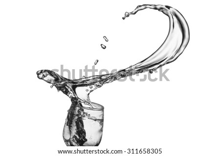 Colourless liquid spills or splashes from a wine glass as it is thrown in the air.