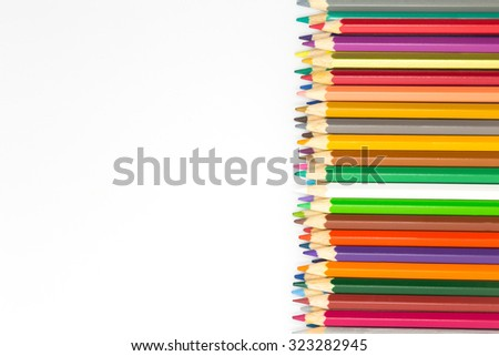 Colours wooden pencils on white background - stock photo
