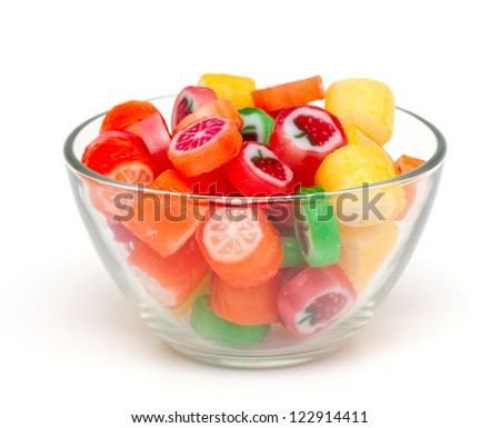 colrofull fruit candies in a bowl isolated on white background