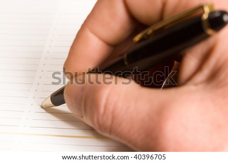 Colse up  signing of contract. Focus on pencil. - stock photo