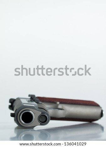 Colt 1911 Commander is a single-action, semi-automatic, magazine-fed, and recoil-operated handgun based on the John M. Browning designed M1911. - stock photo