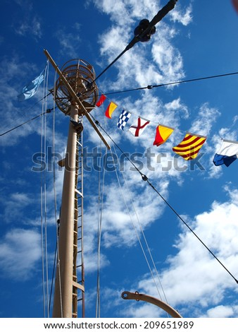 Columbia Lightship Main Light with Nautical Flags Hanging with Wispy Clouds - stock photo