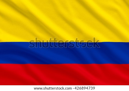 columbia national realistic flag on the fabric texture background - stock photo