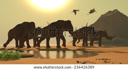 Columbian Mammoth - Jabiru birds fly past a herd of Columbian Mammoths as they make their way across a river delta. - stock photo