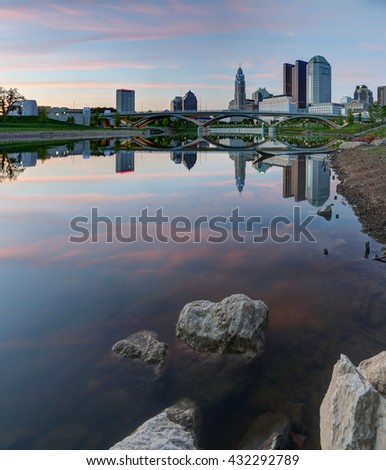 COLUMBUS, OHIO - CIRCA MAY 2016: Evening skyline along the Scioto River at dusk