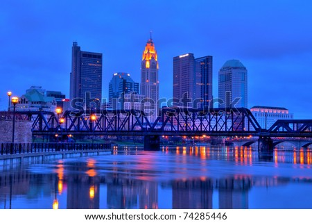 Columbus, Ohio cityscape overlooking the Scioto River at night.