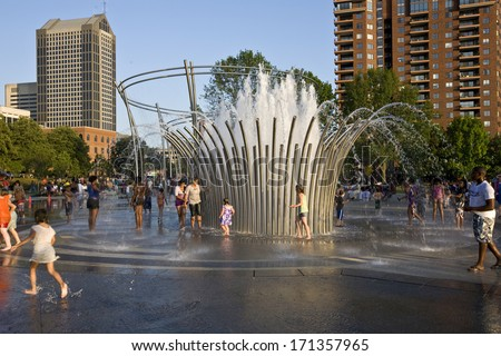COLUMBUS, OHIO - JULY 10, 2011: Thousands attend the grand opening of the Scioto Mile and Bicentennial Park in downtown Columbus. - stock photo