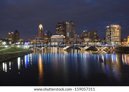 COLUMBUS, OHIO - OCTOBER 18, 2013: The new Rich Street Bridge lights the waters of the Scioto River on October 18, 2013 - stock photo