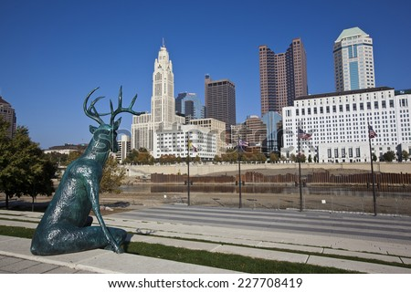 COLUMBUS, OHIO-OCTOBER 25, 2014:  This bronze deer statue designed by artist Terry Allen sits along the bank of the Scioto river. - stock photo