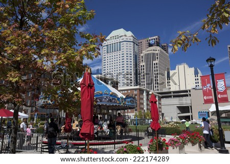COLUMBUS, OHIO-SEPTEMBER 27, 2014:  The Columbus Commons in Columbus, Ohio attracts visitors year round.  The carousel runs spring through fall. - stock photo