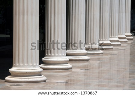 Column array with a Greek doric-style base - stock photo