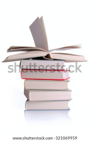 Column of books isolated on white background. - stock photo