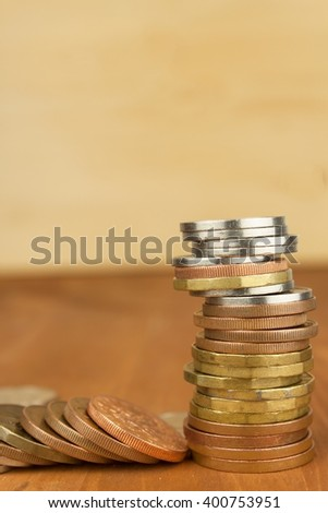 Column of metal coins. The concept of saving. Coins stacked on each other. Pyramid of coins. Rows of coins for finance and banking concept background.  - stock photo