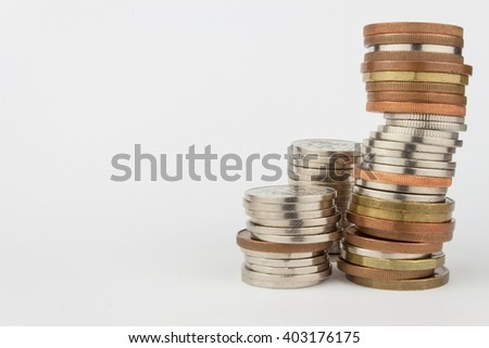 Column of metal coins. The concept of saving. Coins stacked on each other. Pyramid of coins. Rows of coins for finance and banking concept background. Valid Czech coins on a white background. - stock photo