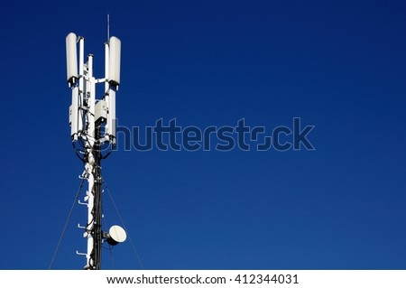column of mobile telecommunication against the background of the blue sky