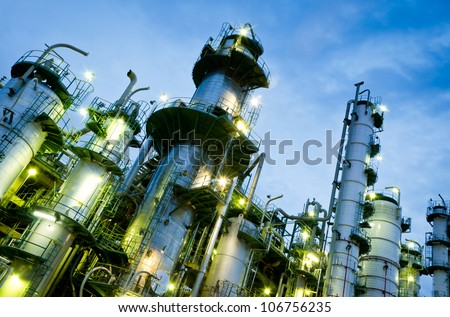 Column tower in petrochemical plant at twilight - stock photo