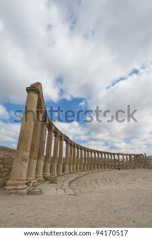 Column with capitals and lintels around the Oval Plaza at the ancient Roman city of Jerash, Jordan. - stock photo