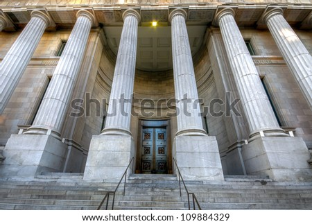 Columned Facade ancient, an old building in Old Montreal. - stock photo