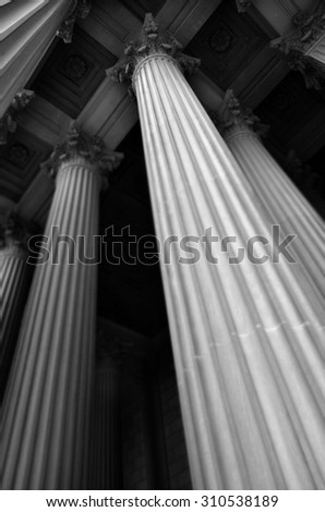Columns and name carved into stone for a Bank or Museum - stock photo