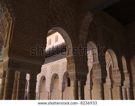 columns and ornate arches of alhambra - stock photo