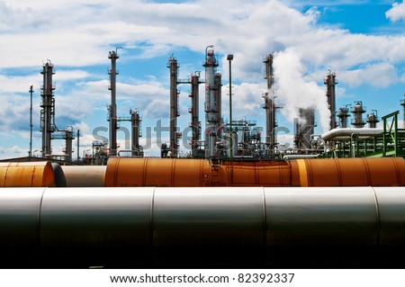 Columns and pipes of a chemical plant - stock photo