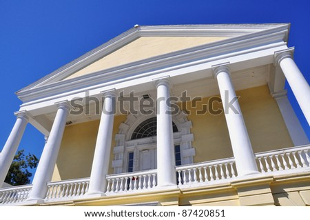 Columns and sky on a courthouse - stock photo