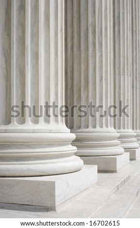 Columns at the front portico of the United States Supreme Court in Washington, DC. - stock photo