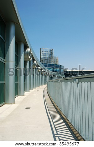 Columns, balcony, and metal railing on modern building; Anaheim Convention Center; Anaheim, California - stock photo