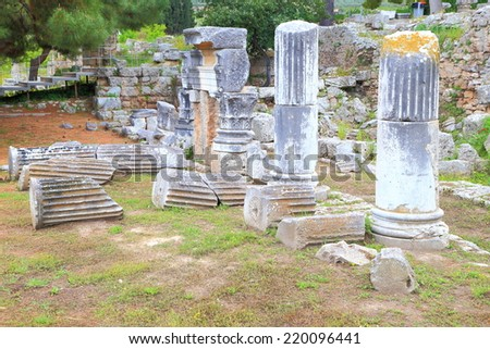 Columns, both standing and fallen, in the ancient sanctuary at Olympia, Greece - stock photo