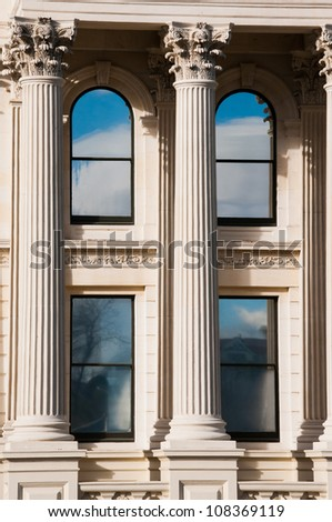 Columns in front of old limestone building - stock photo