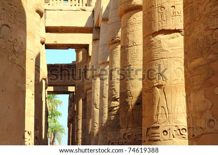 columns in karnak temple with ancient egypt hieroglyphics - stock photo