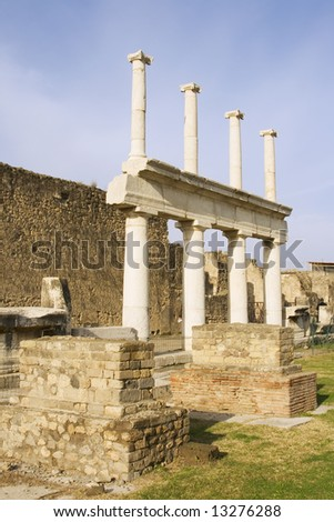 Columns in the ruins of the Pompeii basilica, covered by Mount Vesuvius eruption in 79 AD.