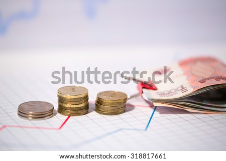 Columns of coins and bills. Business idea. - stock photo