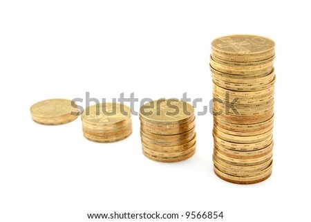 Columns of coins forming a growing chart of wealth