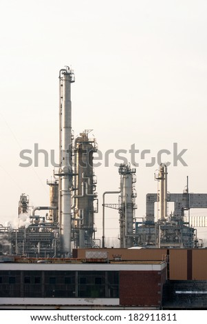 Columns of Oil Refinery at Hazy Day
