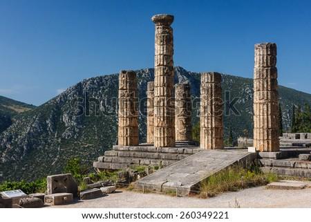 Columns of temple in the ruins of Delphi sanctuary, Greece - stock photo