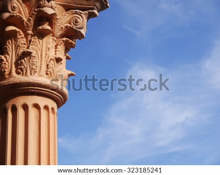 Columns on blue sky background - stock photo