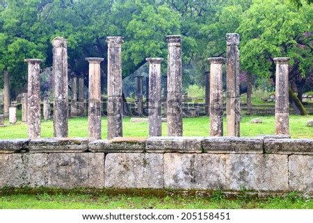 Columns standing in ancient sanctuary at Olympia, Greece - stock photo