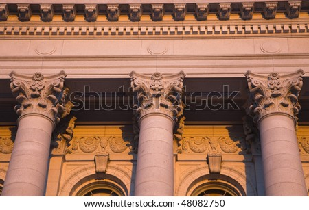 Columns - State Capitol of Wisconsin in Madison in warm light. - stock photo