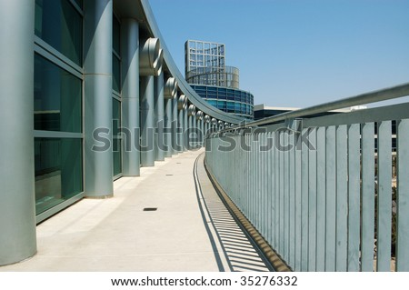 Columns, windows, balcony, and metal railing on modern building; Anaheim Convention Center; Anaheim, California - stock photo