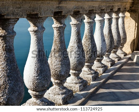 Columns with shadows deep perspective - stock photo