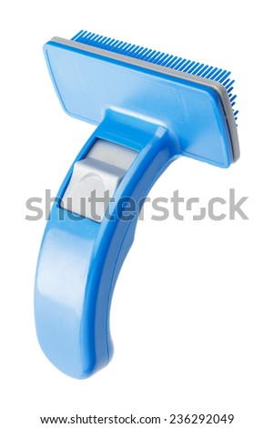 Comb for pet grooming isolated on a white background - stock photo